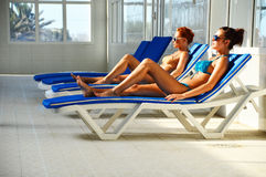Two young women at the swimming pool Stock Photo