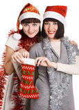 Two young women taking out their Christmas present Stock Images