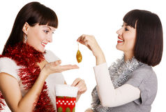 Two young women taking out their Christmas present Royalty Free Stock Photography