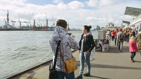 Two young women taking photo on riverside stock footage