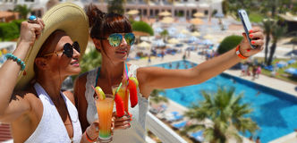 Two young women taking picture of themselves on vacation Royalty Free Stock Photo