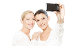 Two young women taking pictures royalty free stock photo