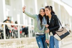 Two young women taking a self portrait of themselves Stock Image