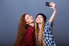 Two young women taking selfie with mobile phone Stock Image