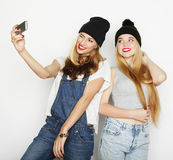 Two young women taking selfie with mobile phone Royalty Free Stock Photos
