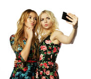 Two young women taking selfie with mobile phone Stock Photography