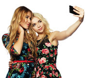 Two young women taking selfie with mobile phone Stock Images