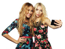 Two young women taking selfie with mobile phone Stock Photos