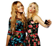 Two young women taking selfie with mobile phone Royalty Free Stock Photo