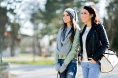 Two young women taking a walk in the park Royalty Free Stock Photo