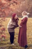 Two young women talk about pregnancy. Two beautiful young women talk about pregnancy Stock Photos