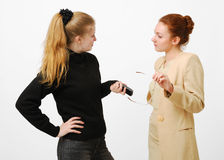 Two young women talking Royalty Free Stock Images