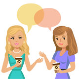 Two young women talking in cafe. Gossip girls. Meeting friends. Royalty Free Stock Photos