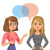Two young women talking. Meeting colleagues or friends. Gossip Royalty Free Stock Photos