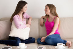 Two young women talking about news and rumors royalty free stock image