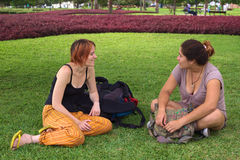 Two Young Women Talking in Park. Two young women (one Peruvian, the other European) talking in a park in Miraflores, Lima, Peru Stock Images