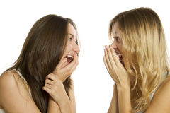 Two young women terrified and screaming Stock Image