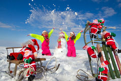 Two young women throwing snow Stock Images