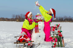 Two young women throwing snow Stock Image