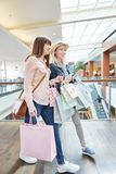 Two young women shopping royalty free stock photo