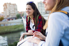 Two young women tourist using their map in the city. Stock Images