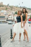 Two young women tourist walks the streets of Tbilisi in Georgia Royalty Free Stock Photo