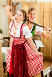 Two young women in traditional Bavarian Tracht Royalty Free Stock Photo