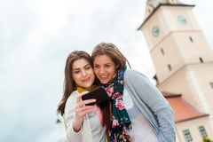 Two young women traveling and having selfies Royalty Free Stock Photos