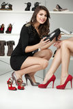 Two young women trying on high heels Royalty Free Stock Image