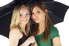 Two young women under umbrella Royalty Free Stock Photography