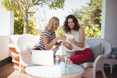 Two young women using digital tablet Stock Photography