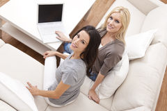 Two Young Women Using Laptop Computer At Home Royalty Free Stock Photography
