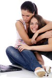 Two young women using laptop Royalty Free Stock Images
