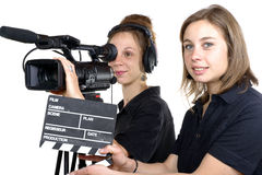 Two young women with a video camera Stock Image