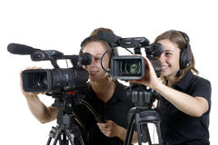 Two young women with  video cameras Royalty Free Stock Photography