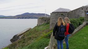 Two young women visit Fort Dunree in Ireland. Travel photography stock video