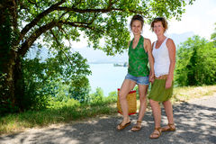 Two young women walking by the lake Royalty Free Stock Photos