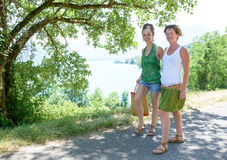 Two young women walking by the lake Stock Photos
