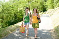 Two young women walking by the lake Royalty Free Stock Image