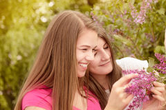 Two young women walking outside in a park Stock Images