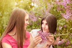 Two young women walking outside in a park Stock Photo