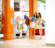 Two young women walking with shopping at the store Stock Photo
