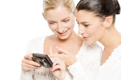 Two young women watching pictures stock photo