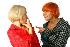 Two young women whispering and surprised Stock Photography