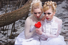Two young women in white dresses Stock Photo