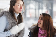 Two young women in winter day Royalty Free Stock Photo