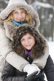 Two young women in winter day Royalty Free Stock Photos