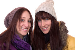 Two young women in winter with scarf and caps Royalty Free Stock Images