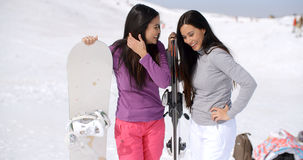 Two young women on a winter vacation Stock Images
