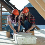 Two young women workers on the roof Royalty Free Stock Image